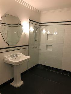 Ensuite bathroom: black hex tiles, white subways, black pencil line and cap, Art Deco mirror, inspired by New York
