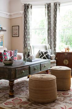 """Sneak Peek: Ali & Jonny Price. """"This table is made from reclaimed wood in India, the poufs are from Urban Outfitters, and the rest of the furniture is thrifted. The pillows on the couch were a gift from Turkey, and the mudcloth pillow on the chair is from Lydali, and is made in Mali."""" #sneakpeek"""