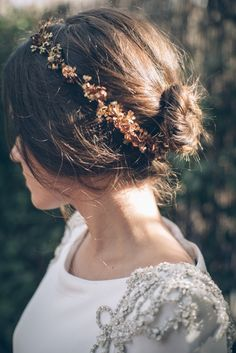 Soft with whisps of hair sticking out....lovely......and love the flowers......