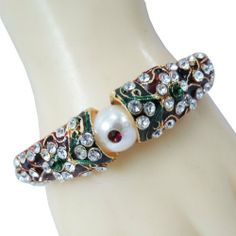 "1 Pc Designer Zircon Kundan Enamel Kada Bangle Traditional Bracelet Jewelry IBA. $18.99. SALE FOR - 1 Bangle, MATERIAL - Alloy. SIZE - 2.3"" Inch Diameter With Hinged Lock"
