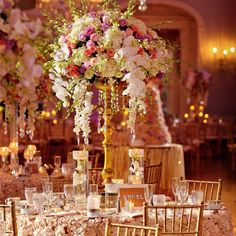Tall golden candelabras with pink, white and lavender roses, white phalaenopsis orchids, hydrangeas and stock. // photo: Jess + Nate Studios // Flowers: Wazzan Floral Design
