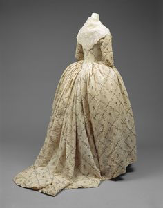 """1784-1787 French Robe à l'anglaise (back view) at the Metropolitan Museum of Art, New York - From the curators' comments: """"Cotton emerged as a fashionable fabric in the 1780s with the chemise à la reine, the cotton shift favored by Marie Antoinette beginning in this turbulent decade."""""""
