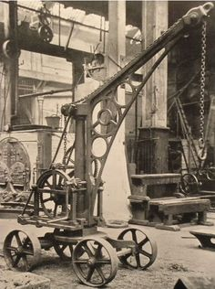 One of the first ever mobile cranes! Looks pretty unstable to me!