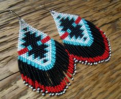 Beaded fringe earrings >Eagle Call< in a geometric Native American motif. Hypo-allergenic surgical steel earring hooks. Majestic beauties..