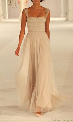 pretty flowing wedding gown. simple. with sequins
