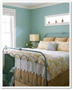Painted bead board creates a charming cottage look in the bedroom.