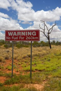 Outback Australia signage - it's important to carry a jerry can with fuel when road tripping around Oz