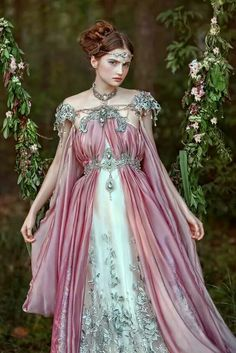 Fantasy never looked so lovely.  I'm not sure who the photographer, or model is. I believe this gown is by Firefly Path. This fantasy gown is dreamy non the less.