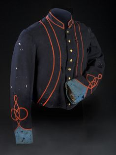 A blue wool short jacket with tight weave pattern sharing characteristics of late war construction, trimmed with two welts of narrow red braid (similar to Birney?s Zouaves) giving the illusion of a false vest, with distinct sky blue cuffs beneath interwoven red sleeve braiding of unknown regimental association.
