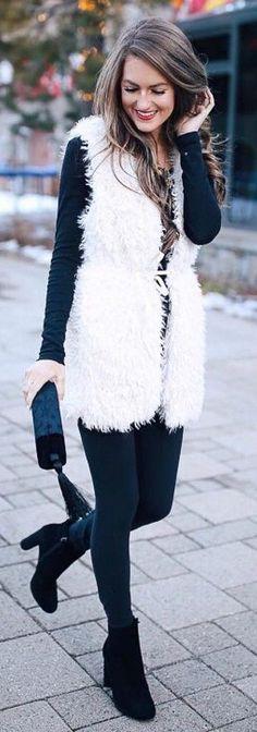 #winter #fashion /  White Faux Fur Vest / Black Knit / Black Leggings / Black Booties