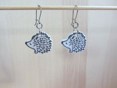 Hedgehog dangle drop earrings black and white hand by ColorfulClay, $7.50