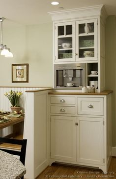 like this little coffee bar area and I love open glass cabinet doors