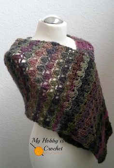 """""""Wrap yourself in this light and lacy shawl, perfect for spring or fall! The beautiful texture in this pattern reminds of flower petals and it pairs beautifully with the self striping yarn. The Flora Wrap is worked in rows back and forth in two parts"""