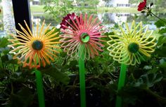 Dollar store craft: How to make cute flower stake decorations out of slinkies