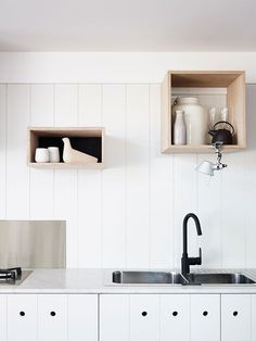 Tolomeo Clip Light in Kitchen, Remodelista and outlets strategically placed behind boxes