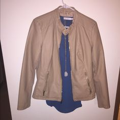 Tan faux leather moto jacket Tan faux leather jacket with stretchy side panels for a tailored fit. Apt. 9 Jackets & Coats