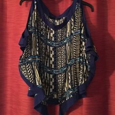 Cold shoulder blouse Tribal print royal blue, hints of yellow black and white. Tie front. Says Medium but fits like 12/14 or large xl. Very forgiving. Tops Blouses