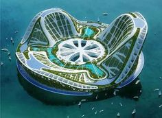 """Vincent Callebaut called this project """"Lilypad"""", but this ecotectural marvel is also called as Floating Ecopolis for Climate Refugees. The whole structure is covered in green walls and roofs, the top portion covered in grasses with the inner portion featuring a palm oasis, and the under portion serving as a bed for natural sea planktons and oceanic plants."""