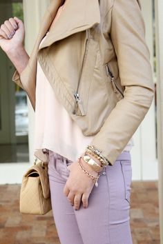 pastel on pastel. lila pants and leather jacket.