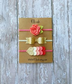 Gold Glitter bow headband set ,bow measure approximately 21/4 long 3/4 attached to skinny elastic headband. Coral felt flower headband measureapproximately 1diameter attached to coral skinny elastic and heart headband attached to coral skinny elastic headband. Dont forget to select the