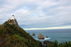 Nugget Point Lighthouse- See why the Catlins needs to be on your New Zealand itinerary Weather In New Zealand, Fly To New Zealand, New Zealand Beach, Visit New Zealand, Best Spring Break Destinations, Top Travel Destinations, Amazing Destinations, Places To Travel, Places To Go