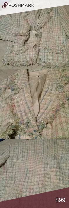 Stunning silk Blazer size 10 Excellent condition made by Ice size 10 snaps in the front shell is 65% silk 37% acrylic 8% polyester lining is 100% polyester colors are pink blue green white lining is paisley This is an absolutely stunning piece I.C.E. Jackets & Coats