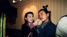 Charming Maggie Cheung Man-yuk and singer Leslie Cheung Kwok-wing attending the opening ceremony of hairdresser Kim Robinson's branch of Le Salon Orient in Times Square. Leslie Cheung, Maggie Cheung, Hk Movie, Singing Contest, Golden Time, Michelle Yeoh, Film Awards, Couture Week, Pop Singers