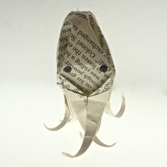 Origami ornaments - Octopus, owl, kawaii bow, lotus flower. $12.00, via Etsy.