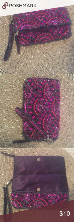 🛍3 for$20🛍ALDO wristlet/clutch 💗 Gorgeous beaded bag. Wristlet can be removed. Most beading in place. A few minor damages as pictured, but cant tell when using. (Wristlet missing beads, bag had some beads glued back on, any stains are nailpolish due to this being my nailpolish bag😬) Zipper. Snap buttons. Plenty of room for everyday necessities! Super cute! Aldo Bags Clutches & Wristlets