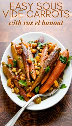 Want an easy, foolproof side dish? This easy Moroccan carrot recipe is seasoned with ras el hanout spices, sweet raisins and toasted pine nuts. Cook the carrots via sous vide or roast them in the oven. A delicious fall or winter side dish with rotisserie chicken or pork. #carrotrecipe #carrotsidedish