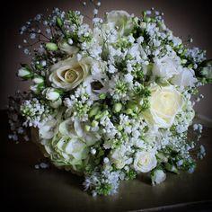 Winter white bouquet. White Hydrangea, lilacs, Gypsophila, Bouvardia, Lisianthus, Avalanche and White Lady Roses