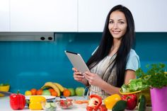 AntiInflammatory 101: Woman on Tablet in Kitchen with Fruits and Vegetables