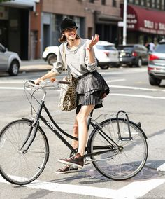 loving the horseriding helmet here! Used to do it a couple of years ago too :) seriously cool outfit & tres chic bike action. NYC. #LeeOliveira