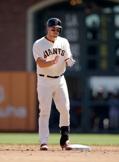 SAN FRANCISCO, CA - AUGUST 31: Andrew Susac #34 of the San Francisco Giants reacts after he hit a double that scored Pablo Sandoval #48 in the second inning of their game against the Milwaukee Brewers at AT&T Park on August 31, 2014 in San Francisco, California. (Photo by Ezra Shaw/Getty Images)