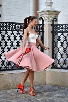 Vaporous pink skirt with red heels and purse