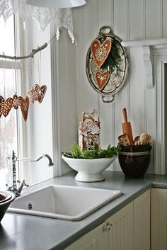 Country kitchen Christmas decor by Vibeke Design I love the idea of using a branch to hang decorations across a window Swedish Christmas, Cottage Christmas, Christmas Gingerbread, Christmas Kitchen, Merry Little Christmas, Scandinavian Christmas, Winter Christmas, Christmas Home, Christmas Baking