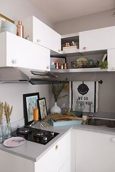 Facing the bar cart is this small kitchen! Instead of renovating your kitchen, you may also want to simply paint your cabinets and replace the cabinet handles. These simple tricks are easy and affordable ways to instantly improve the space.