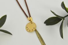 """Items similar to Gold Necklace - hand stamped """"vibes"""" with brass charm and feather pendant, brown leather accent on Etsy Washer Necklace, Pendant Necklace, Hand Stamped Jewelry, Brown Leather, Gems, Jewels, Trending Outfits, Unique Jewelry, Handmade Gifts"""