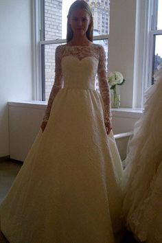 I love lace and long sleeves; this would be great with a colored sash - Oscar de la Renta bridal fall 2013