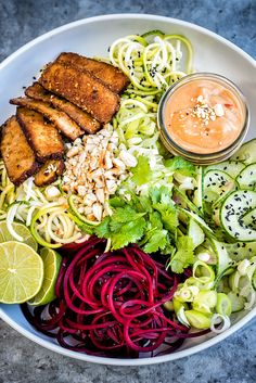 A medley of spiralized vegetable noodles with smoked tofu and spicy peanut sauce - a healthy and delicious vegan recipe | Supergolden Bakes