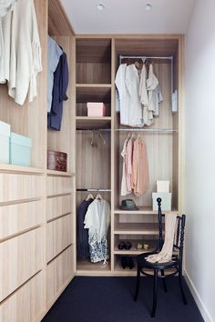 This small, light wood, walk-in closet has floor-to-ceiling mixed storage.