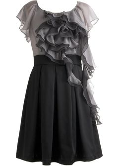 Sugar Spun Chiffon Dress: Features a delicate chiffon bodice framed by sheer, flouncy flutter sleeves, swirled monochrome flower-like arrangement of ruffles traveling down the front, ultra-thick A-line skirt bursting with precise pleats, and a keyhole closure at nape to finish.