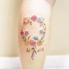 Floral female gender symbol tattoo by Luiza Oliveira