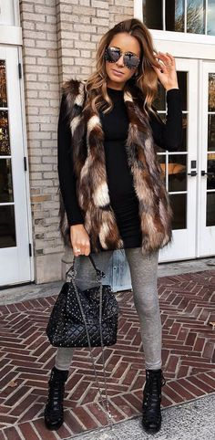 #winter #outfits brown and black fur vest with gray leggings