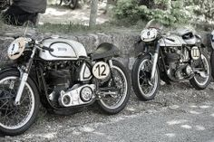 2 Norton single racers against a wall. From CAFE' RACER CULTURE