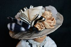 Lady Grantham's hat is pure cream silk decorated with satin and chiffon flowers, satin ribbon, faux zebra hide and netting.