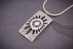 """Silver Rectangular Sunflower Pendant   This handcrafted, sterling silver pendant is available with a 16"""" or 18"""" sterling silver snake chain."""