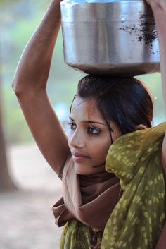 Indian village girl carrying water