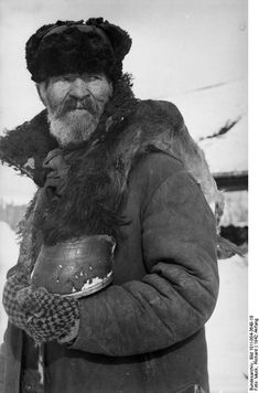 Eastern Front, Battle of Cholm, Jan 1942: The local population was caught inside the town and suffered equally with the Germans. This local man has found some protein: a foot of a horse.
