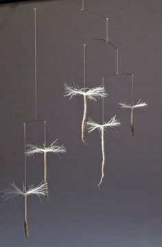 Anu Völp felt sculptures: mobile - look like dandelions